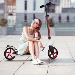 a girl sitting on a MONODEAL Adjustable Kick Scooter for Adults