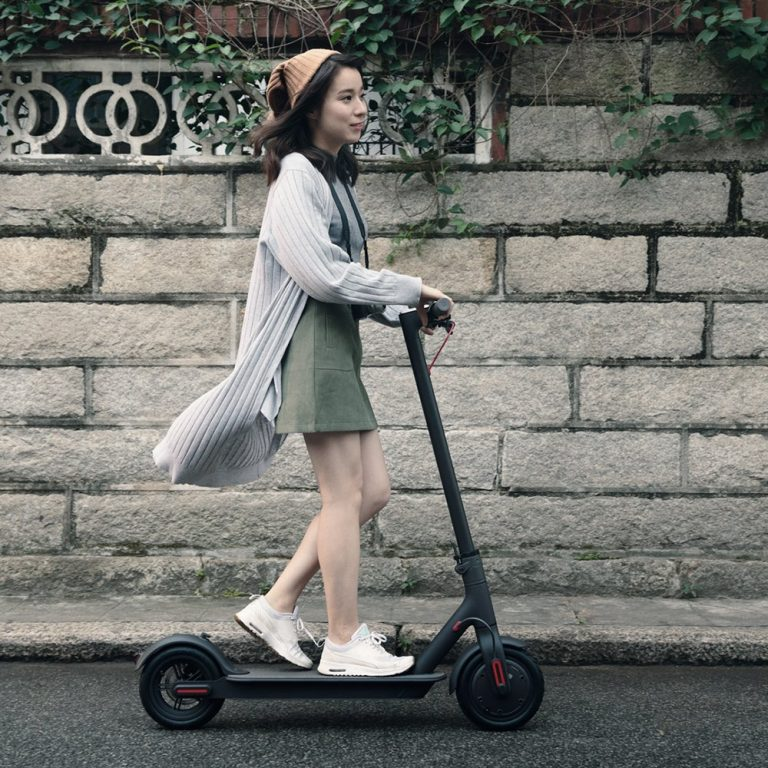 xiaomi mi electric scooter person riding